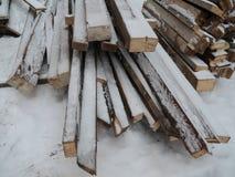 Snowy wood stapled Royalty Free Stock Photo