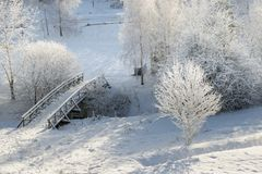 Snowy bridge from above 2. Snowy, wooden bridge in a winter day. View from above Royalty Free Stock Photography