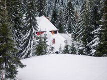 Snowy Wooden Cottage At Muntele Mic Resort Stock Photos