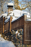 Snowy wooden fence. Snowy brown wooden fence on the stone basis Stock Photos