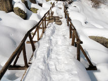 Snowy Wooden Footbridge. Old wooden footbridge in thick snow Royalty Free Stock Image