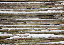 Snowy wooden pole fence wall in winter Royalty Free Stock Images