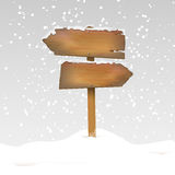 Snowy wooden signpost Stock Photography