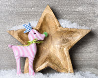 Snowy wooden star with reindeer Royalty Free Stock Photography