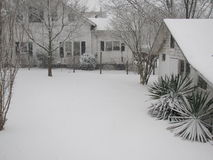 Snowy yard and landscape of a home Royalty Free Stock Photo