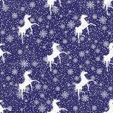 Snoyflakes y caballos del invierno. Fondo inconsútil  Foto de archivo
