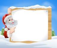 Snöplatsjul Santa Sign Fotografering för Bildbyråer
