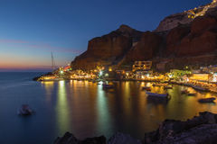 Sntorini - The Amoudi harbor of Oia at dusk. SANTORINI, GREECE - OCTOBER 5, 2015: The Amoudi harbor of Oia at dusk Stock Image