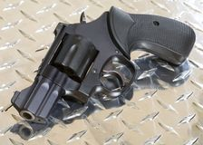 Snub nose revolver. Small black revolver for self defense on armor plate steel Royalty Free Stock Image