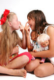 Snub-nosed girls. With dolls in a cheerful mood Royalty Free Stock Image