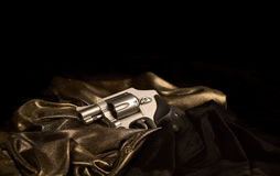 Snubnose Revolver on Gold Satin Royalty Free Stock Photo