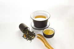 Snuff cup with green, flower tea, gaiwan and a tea cup on a whit. E background Royalty Free Stock Photography