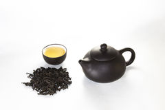 Snuff cup with green, flower tea, gaiwan and a tea cup. On a white background Stock Image