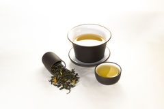 Snuff cup with green, flower tea, gaiwan and a tea cup. On a white background Stock Images