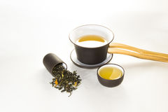 Snuff cup with green, flower tea, gaiwan and a tea cup. On a white background Royalty Free Stock Image