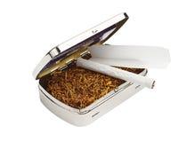 Snuffbox, tobak och cigaretter Arkivfoton