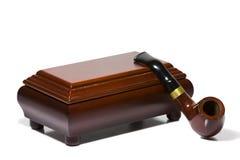 Snuffboxen och tobak leda i rör Arkivbilder