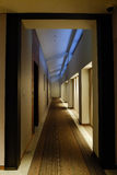 A snug corridor in the hotel with carpet Stock Photo