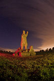 Snugburys hay statue of a polar bear light painted Royalty Free Stock Image