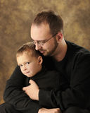 Snuggling Daddy and Son Stock Photo