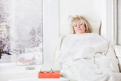 Snuggling under a blanket Royalty Free Stock Photos