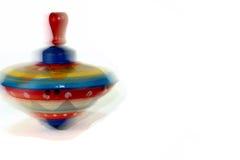 Snurröverkant - tappningTins Childs leksak royaltyfria foton