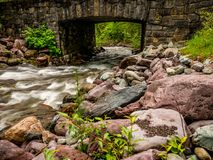 Snyder Creek Passes Right Under This Medieval Looking Stone Bridge stock image