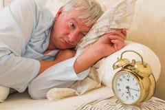Soñoliento en cama Foto de archivo libre de regalías