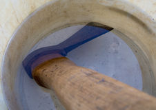 Soak the ax in water to prevent falling off the ax Royalty Free Stock Photography