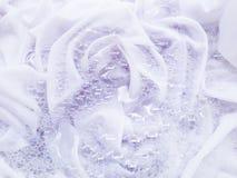 Soak a cloth before washing. White cloth Royalty Free Stock Photo