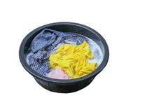 Soak dirty clothes in the basin black for clean isolated on white background and clipping path.  Stock Photo