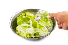 Soak vegetable in water with salt to remove pesticides residues Stock Photos