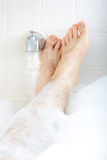 Soaking in the bathtub. Stock Image