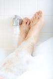 Soaking in the bathtub. Stock Image