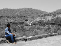Soaking in the moment. Boy at Ajanta Caves, India Royalty Free Stock Photography