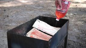 Soaking wood logs in the grill before BBQ stock video