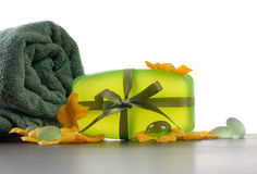 Soap. Green soap and towel on a table Royalty Free Stock Photos