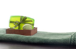 Soap. Green soap and towel on a table Stock Images