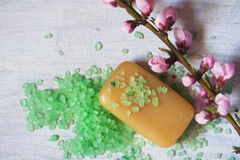 Soap, aromatic bath salt, twig with spring flowers Stock Photo