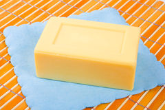 Soap on the bamboo table-cloth Stock Photos