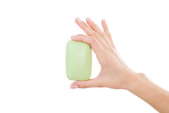 Soap bar. Close-up of woman holding soap bar while isolated on white stock image