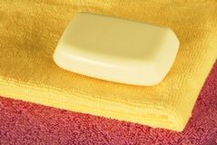 Soap bar on colorful towels Royalty Free Stock Photos