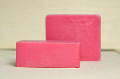 Soap bar flavor with strawberry ingredient isolated on wooden bo Royalty Free Stock Photo