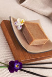 Soap bar and incense sticks. Wellness background. Royalty Free Stock Images