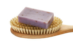 Soap bar with natural ingredients on massage brush. On white isolated Stock Photography