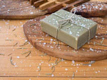 Soap bar on the olive tree textured board Stock Images