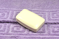 Soap bar. Bar of soap on purple towel Royalty Free Stock Photo