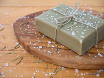 Soap bar tied with jute rope on the olive tree textured board Royalty Free Stock Image