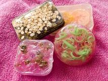 Soap bars. Colorful soap bars laying at pink towel royalty free stock photos