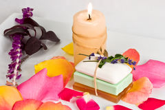 Soap bars and candle. Soap bars and aromatic candle decorated with rose petals Stock Image